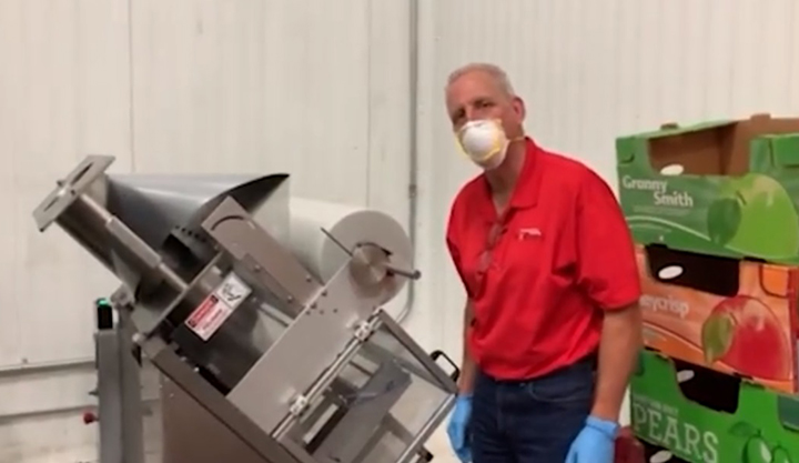 John Kreger and the Montgomery County Food Bank bagging machine