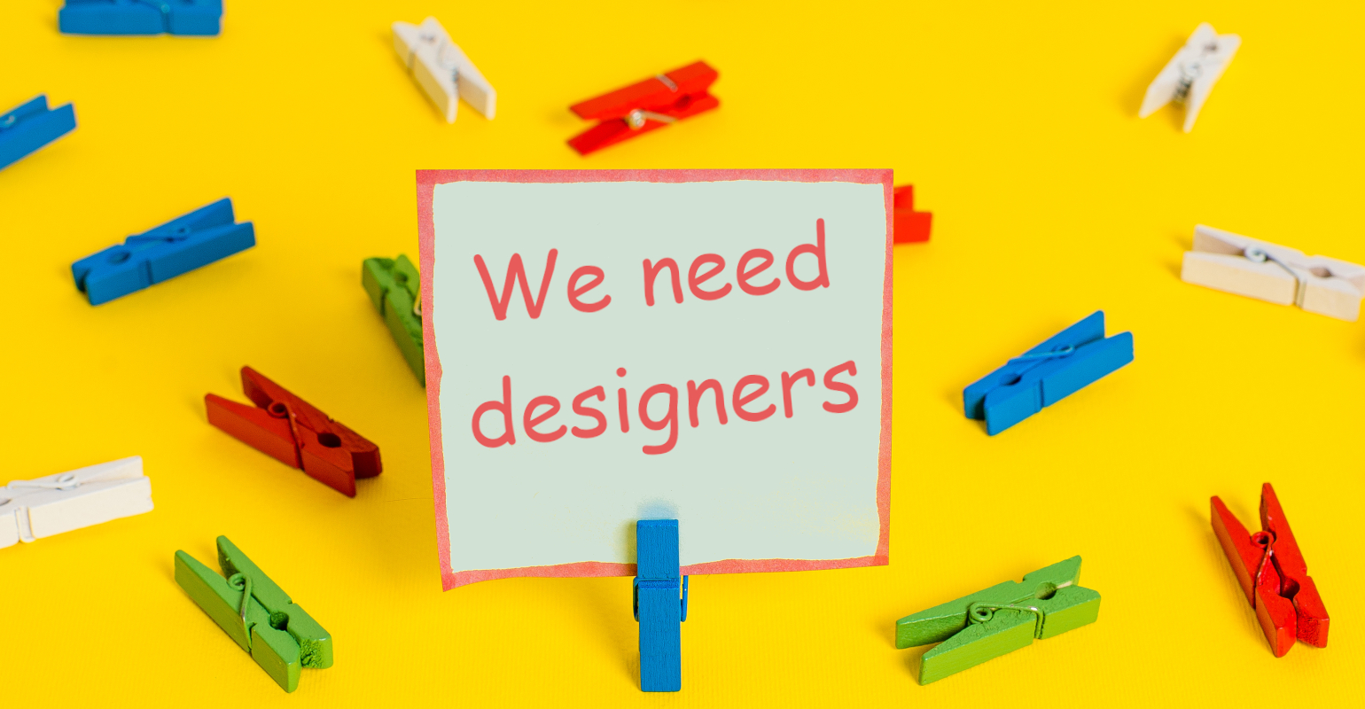 Need-Designers-Sign-AdobeStock_285950052-Artur.jpeg