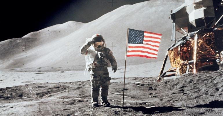 1971: Astronaut David Scott, commander, gives a military salute
